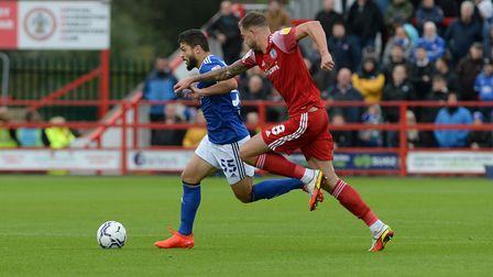Sam Morsy is chased by man of the match Harry Pell at Accrington Stanley.