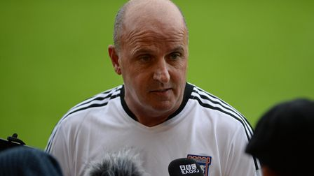 Paul Cook faces the media at Accrington Stanley.