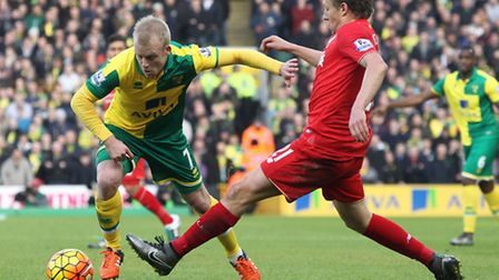 Steven Naismith of Norwich and Lucas Leiva of Liverpool in action during the Barclays Premier League