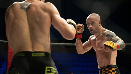 Azi Thomas looks for an opening in his title fight with Jeremy Petley at Contenders 31