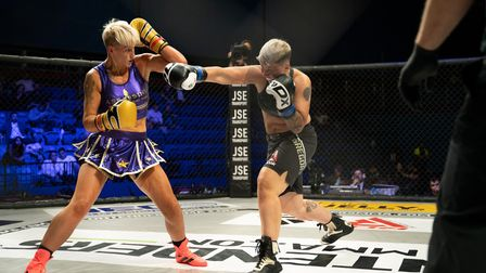 Carla McKenzie Le Roy, left, blocks a shot during her win over Rox Mac at Contenders 31