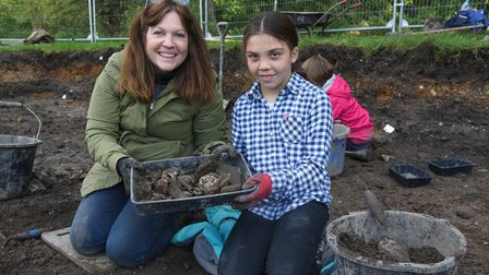 Julie and Ira Smith-Adams with some of the artifacts they have found on one of the excavation sites