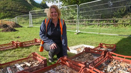 Clare Wootton, post excavation supervisor, with some of the cleaned up artefacts at Clare Castle. Pi
