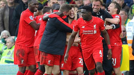 Jurgen Klopp joins the celebrations after Liverpool's 95th minute winner at Carrow Road. Picture by