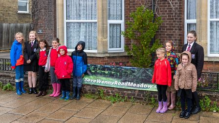 Some of the children with the 'Save Wenny Road Meadow' banner in Chatteris.