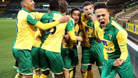 Todd Cantwell of Norwich City U18s is mobbed by his team-mates after he scores the winning goal to p
