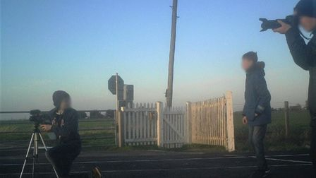 Children taking photos on a rail line at March is being used as part of a nationwide safety campaign