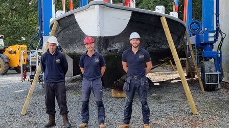 The team atCox's Boatyard with the wherry.