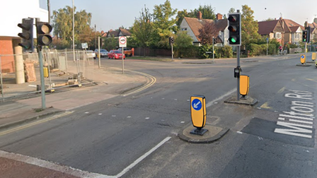 Driver flees scene of crash at junction of Gilbert Road and Milton Road in Cambridgethat left woman cyclist hospitalised.