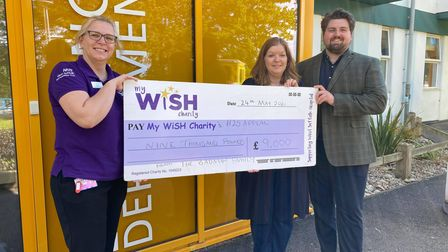 Jill and Harry Badman hand over a cheque for £9,000 to Claire Thompson,