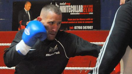 Ryan Walsh trains with trainer Graham Everett ahead of his British featherweight boxing title defenc