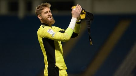 Smiling Tomas Holy applauds the travelling fans after the win and a clean sheet at Gillingham