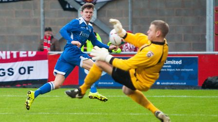 Harvey Hodd of Lowestoft Town sees a shot on goal saved by Dave Carnell of FC United of Manchester d