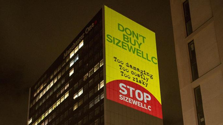 Stop Sizewell C lit up Manchester One