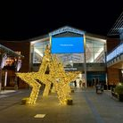 Lit up golden stars light the entrance to Chantry Place shopping centre