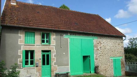 Cottage with green doors and shutters for sale in France