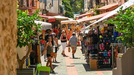 A busy shopping street in summer in Banyuls-sur-Mer, France