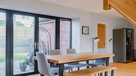 Contemporary dining area with bench seating and patio doors in this 3-bed home for sale in Strumpshaw, Norfolk