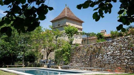 Stone pigeonnier with swimming pool below