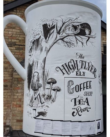 Giant cuppa outside High Flyer with the enforcement notice now showing around the bottom.