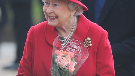 The Queen was presented with flowers by well wishers after morning service at West Newton Church. Pi