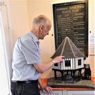 Richard Bultitude pictured with the model he made, now on display at Wymondham Heritage Museum.