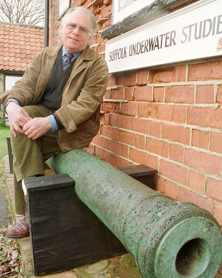 Stuart Bacon, a now-retired marine biologist pictured here with a 16th century cannon
