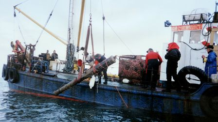 Stuart Bacon and his team retrieving the bronze cannon from the sea in 1994