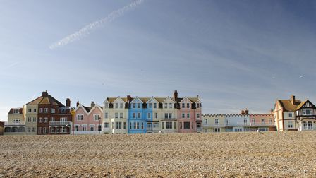 The colourful row of seafront houses in the popular coastal town of Aldeburgh, Suffolk, UK on a sunn