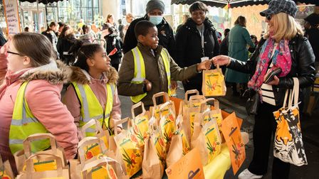 Youngsters raising funds for food charities selling theproduce they grew themselves at school