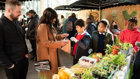 Selling produce grown in school... pupils from Tower Bridge Primary at Borough Market