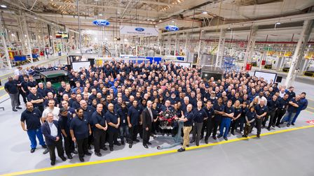 A large group of employees stand together at Ford Dagenham
