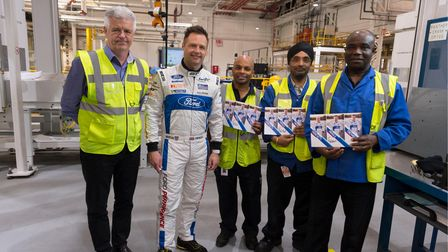 Ford Chip Ganassi Team UK driver Andy Priaulx withFord Dagenham workers, holding signed team photos.
