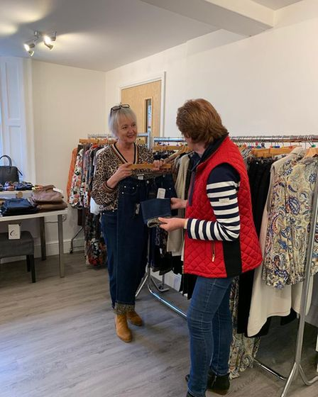 Sarah Simonds helping a customer out inside her new shop on London Street in Swaffham.
