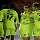 Dan Kemp of Leyton Orient scores the fourth goal for his team and celebrates with his team mates dur