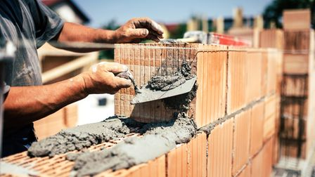 Building materials and a brick-layer