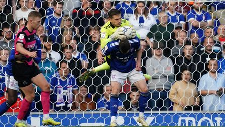 Ipswich keeper Vaclav Hladky climbing over teammate George Edmundson as he makes a second half save