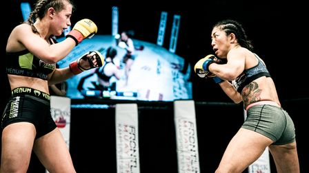 Chloe Cooke, left, outlasted Ako Murata in a thrilling title fight at Cage Warriors Academy South East 26