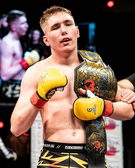 David Cooke made it a two-belt family night as he lifted the amateur lightweight title at Cage Warriors Academy South East 26