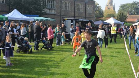 The traditional 'egg and spoon' races turned into 'apple on spoon' races at Ely's Apple and Harvest Fayre.
