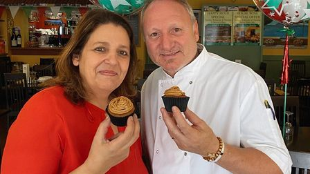 Owners of Vesuvio restaurant in Whittlesey with cupcake