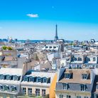 Paris rooftops in the Marais area with the Eiffel Tower in background