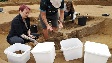 Suffolk Mind volunteers excavating and taking environmental samples from the cellar of an Anglo-Saxon hut