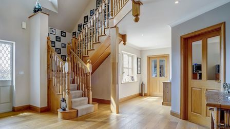 Large entrance hall with wooden flooring in this £1.4m property for sale in Rollesby, Norfolk