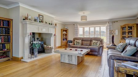 Light and spacious sitting room with huge fireplace in this £1.4m equestrian property for sale in Rollesby