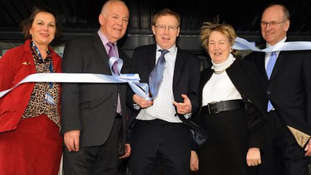 Paul Farmer, centre, national Mind CEO, cuts the ribbon to open Norwich Mind's new Wellbeing Centre