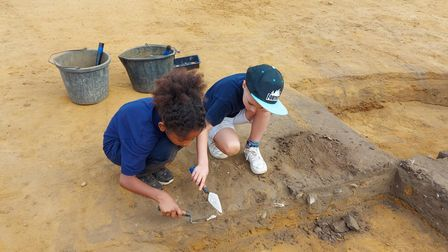 Children from Rendlesham Primary School excavating the cellar of an Anglo-Saxon hut