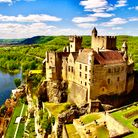A French castle on a cliff overlooking a river