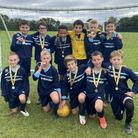 Takeley Primary School's boys show off their medals after the tournament.