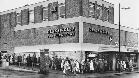 Pensioners queue round the St Andrews Street Glasswells shop in Bury St Edmunds waiting for their free sugar and tea